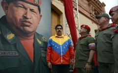 "(FILES) (L to R): Venezuelan Vice President Nicolas Maduro, the president of the National Assembly, Diosdado Cabello and Venezuelan Defence Minister, Diego Molero stand by a huge portrait of Venezuelan President Hugo Chavez during the conmemoration of the 1992 failed coup led by Chavez, then an army lieutenant colonel, against ruling president Carlos Andres Perez, at the ""4 de Febrero"" army barracks in Caracas, on February 4, 2013. Chavez will be moved to the 4 de Febrero barracks, where he will lie in state for longer than had been planned then be embalmed ""like Lenin,"" interim leader Nicolas Maduro said on March 7, 2013.    AFP PHOTO/Juan BARRETO"