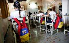 "Backpacks with the colours of the Venezuelan national flag hang on chairs during a class at an improvised classroom above a state-run supermarket, which is part of state school Monsenor Marco Tulio Ramirez Roa, in La Fria, Venezuela, June 1, 2016. REUTERS/Carlos Garcia Rawlins SEARCH ""VENEZUELA SCHOOL"" FOR THIS STORY. SEARCH ""THE WIDER IMAGE"" FOR ALL STORIES"