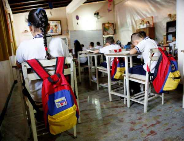 """Backpacks with the colours of the Venezuelan national flag hang on chairs during a class at an improvised classroom above a state-run supermarket, which is part of state school Monsenor Marco Tulio Ramirez Roa, in La Fria, Venezuela, June 1, 2016. REUTERS/Carlos Garcia Rawlins SEARCH """"VENEZUELA SCHOOL"""" FOR THIS STORY. SEARCH """"THE WIDER IMAGE"""" FOR ALL STORIES"""