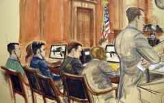 In this courtroom sketch, the trial of two nephews of Venezuela's first lady proceeds Monday, Nov. 14, 2016 in New York with, from left, Francisco Flores, Efrain Campo, defense attorney John Zach, defense attorney Randall Jackson, Assistant US attorney Emil Bove, standing, and Judge Paul Crotty seated at the bench. Campo and Flores are accused of conspiring to import 800 kilograms of cocaine into the U.S. before they were arrested in Haiti.  (AP Photo/Elizabeth Williams)