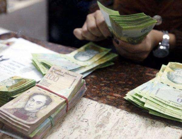 2015-02-26t163611z_1007880001_lynxmpeb1p0q1_rtroptp_4_negocios-mercados-venezuela-dolar-900x600