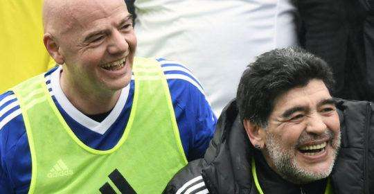 Argentina's former soccer player Diego Maradona, right, and FIFA President Gianni Infantino, left, share a laugh during a soccer match with FIFA Legends at the home of FIFA in Zurich, Switzerland, Monday, Jan. 9, 2017. (Walter Bieri/Keystone via AP)
