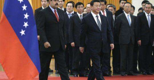 Venezuela's President Nicolas Maduro (front L) walks with China's President Xi Jinping as they arrive for a welcome ceremony at the Great Hall of the People in Beijing, January 7, 2015. REUTERS/Andy Wong/Pool (CHINA - Tags: POLITICS)